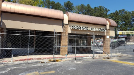 The former Prestige Cleaners in the North Springs Center is fenced off for environmental cleanup work of leaked chemical solvents, according to the state Environmental Protection Division. (Photo John Ruch)