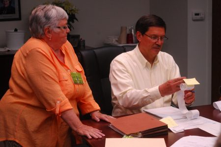 Sandy Springs City Clerk Michael Casey counts ballots as poll manager April Volk looks on.