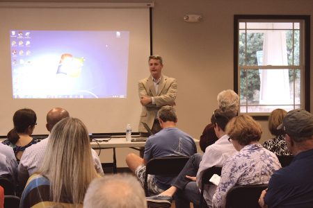 Brookhaven Mayor John Ernst talks to a packed room at the Ashford Park Community Center during his traffic town hall meeting. (Photo Dyana Bagby)
