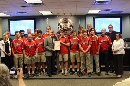 Dunwoody Mayor Denis Shortal presents a proclamation to the Peachtree Charter Middle School Patriots baseball team congratulating them for winning the Dunwoody Senior Baseball Middle School Championship.