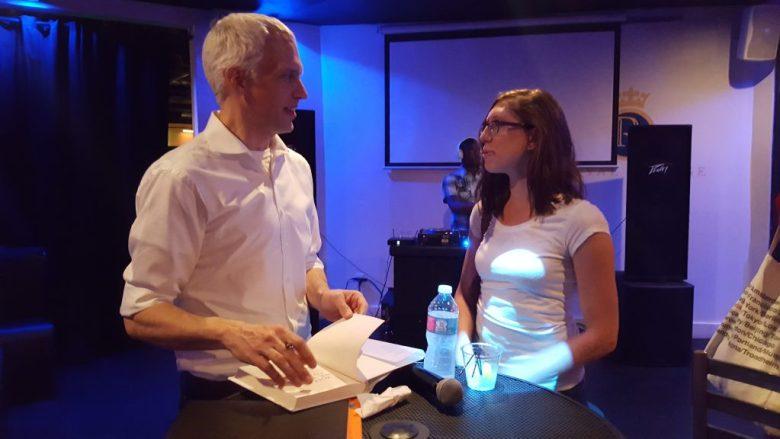 Ryan Gravel, left, signs his book for Cross Keys High School teacher Rebekah Morris at Brookhaven's Royal Lounge.