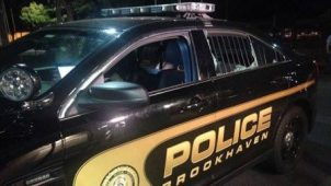 A bullet struck the rear window of the Brookhaven Police Car, shattering it. (via BPD)