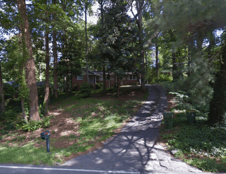 A Google Earth image of the house at 550 Hammond Drive.