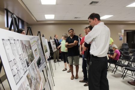 Shri Ranganathan, center, who lives on Canoochee Drive, discusses proposed plans for the Solis Dresden City Homes mixed-use development. (Photo Dyana Bagby)