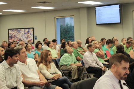 Brookhaven Heights residents supporting implementing traffic calming measures in their neighborhood wore green shirts to the June 7 City Council meeting. Those opposed sat on the opposite side of the room. (Photo Dyana Bagby)