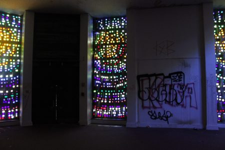 Stained glass and graffiti in the chapel.