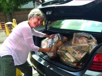 Second Helpings 1-3: Second Helpings Atlanta volunteer Diana Silverman picks up excess bread, sandwiches, salads and desserts from the Fresh Market at Roswell Wieuca Shopping Center. (Credit: Donna Williams Lewis)