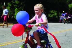 Catherine Whipple, who's 4, paraded in patriotic colors and balloons.