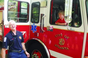 Atlanta firefighter Glenn Barry of Station 27 shared a good laugh with 4-year-old Landon Reichenbach.