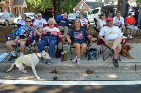 Frances Worthy, who's 94, took in the parade with grandson Parker, at left with dog, Nellie, and daughter Mary Jane Hollander and her son-in-law Todd Hollander.
