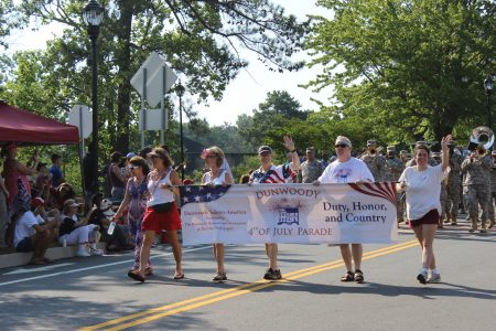 Dunwoody Homeowners Association board members lead the 2016 Fourth of July parade. (Photo Dyana Bagby)