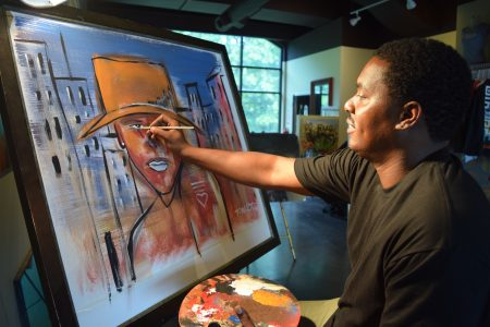 photos by jacyln turner Dakoro Edwards, who goes by his first name, has opened a contemporary art gallery in City Walk in Sandy Springs. (Photo Jaclyn Turner)