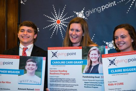 Lovett School students, from left, Chris Weaver, Caroline Carr Grant and Claire Biggerstaff, with their project poster boards at the end of the Sparks Student Awards Ceremony. (Special)