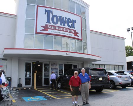 Tower Beer, Wine & Spirits Owner Michael Greenbaum, left, and General Manager David Halliday in front of their store on Piedmont Road. (Photo John Ruch)