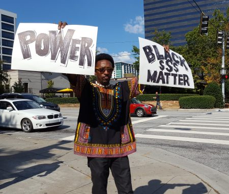 A protester on Lenox Road. (Photo John Ruch)