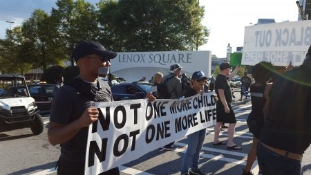 Protesters block the main Peachtree Road entrance to Lenox Square Mall. (Photo John Ruch)