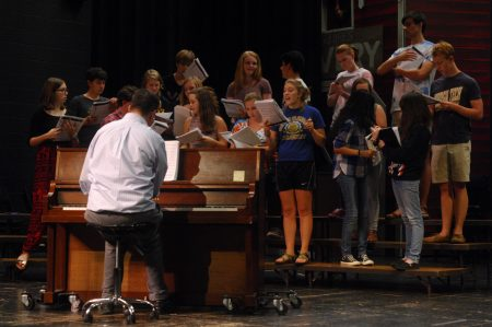 """Dunwoody High School Music Director Mark Lamback, at piano, leads the school's theater group through rehearsal of """"The 25th Annual Putnam County Spelling Bee"""" on Sept. 8. (Photo Phil Mosier)"""