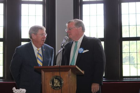 """U.S. Sen. Johnny Iskason, left, spoke at the school's celebration of Constitution Day, and James Comerford's collection opened that same day, Sept 19. Comerford, right, wears a 1990 """"Iskason for governor"""" button. (Photo Dyana Bagby)"""