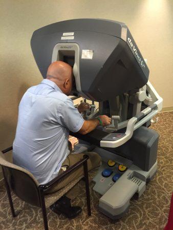 Deputy Mayor Moshe Davidovich, deputy mayor of Mateh Asher, Israel, tries a robotic surgery machine during the Sept. 12 Emory Saint Joseph's Hospital visit. (Photo Grace Huseth)