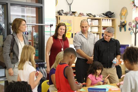 From left, Yael Ron of the Western Galilee Cluster; Principal Lisa Nash; Yariv Hameiri of the Treasures of the Galilee tourism organization; and Mayor Sivan Yechilei of Kfar Vradim observe schoolchildren at work at Fulton County's Heards Ferry Elementary School during an Israeli delegation visit in September. (City of Sandy Springs)