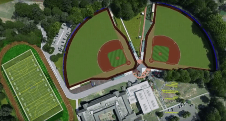 An aerial view of the two new baseball fields to be built at Peachtree Charter Middle School with a view also of the football field and track area. Extra parking spaces are also to be built as seen by the paved spot in the top left corner.