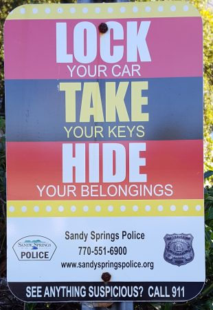 A Sandy Springs Police Department parking lot sign warning about car break-ins. (Photo John Ruch)