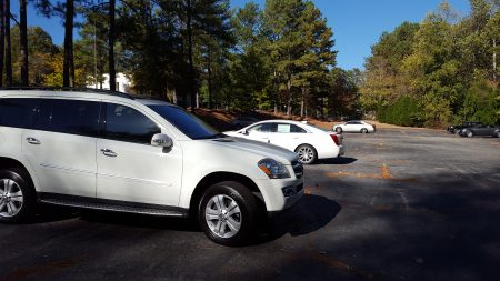 Cars stored in the lot rented by Classic Cadillac and Subaru at the North Fulton County Government Services Center on Roswell Road on Oct. 23. (Photo John Ruch)