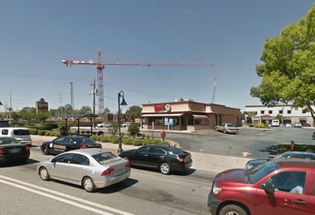 The Wendy's at 6240 Roswell Road with the City Springs development in the background as it appeared earlier this year in a Google Earth image.