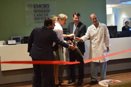 Cutting the ribbon at the Winship Cancer Institute dedication are, from left, Dr. Peter Rossi, director of radiation oncology; Dr. Stephen Szabo, director of community oncology; Heather Dexter, CEO of Emory Saint Joseph's Hospital; Rusty Paul, mayor of Sandy Springs; and Dr. David Kooby, director of surgical oncology. (Photo Jaclyn Turner)