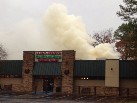 Smoke billows from the Dec. 4 fire at the Sandy Springs Gun Club and Range at 8040 Roswell Road in a photo tweeted by the city of Sandy Springs.