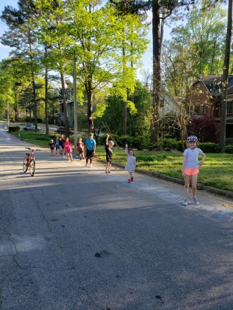 Children play in the Statewood Road hopscotch squares.