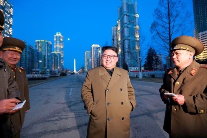 North Korean leader Kim Jong Un provides field guidance at the construction site of Ryomyong Street