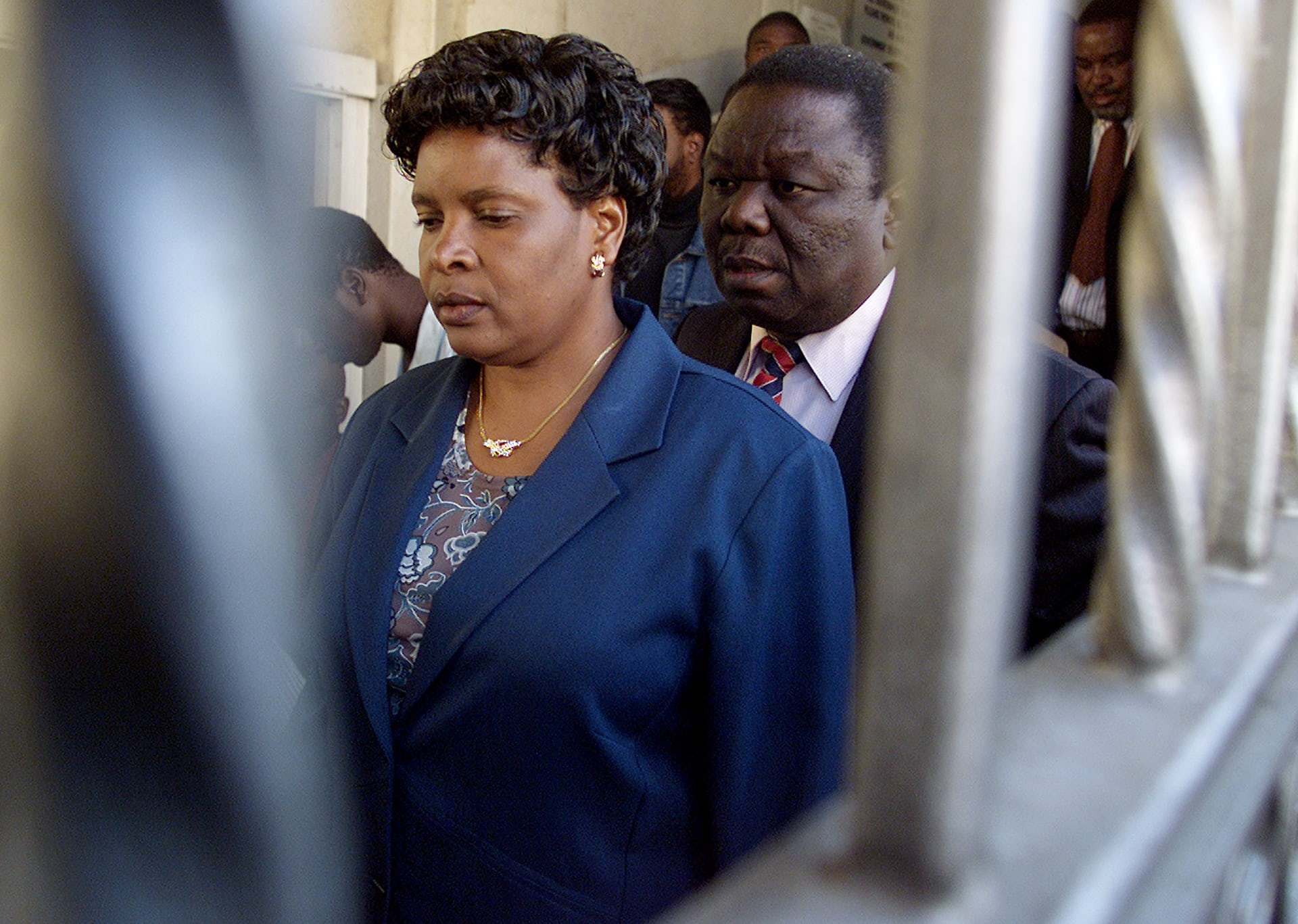 Tsvangirai arrives at the high court in Harare with his wife Susan in May 2003, facing treason charges for allegedly plotting to assassinate Mugabe.