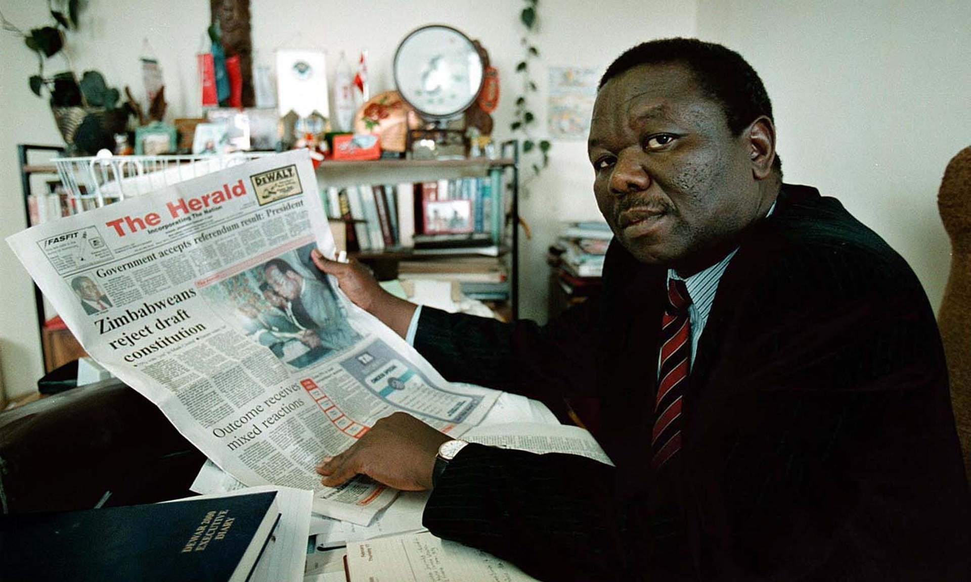 Tsvangirai reads about the government's shock defeat in a referendum on a proposed new constitution in February 2000.