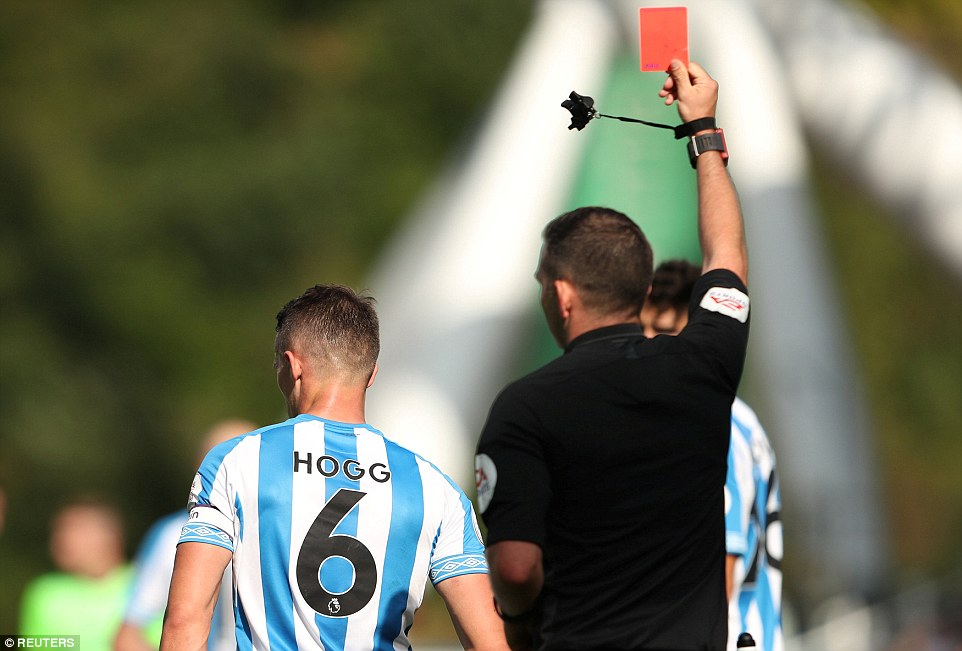 Referee Michael Oliver booked Arter but had no doubts when he showed Hogg a straight red card for violent conduct