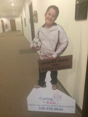 Poster outside of the Caring for Kids office. Photo by Elizabeth Randolph