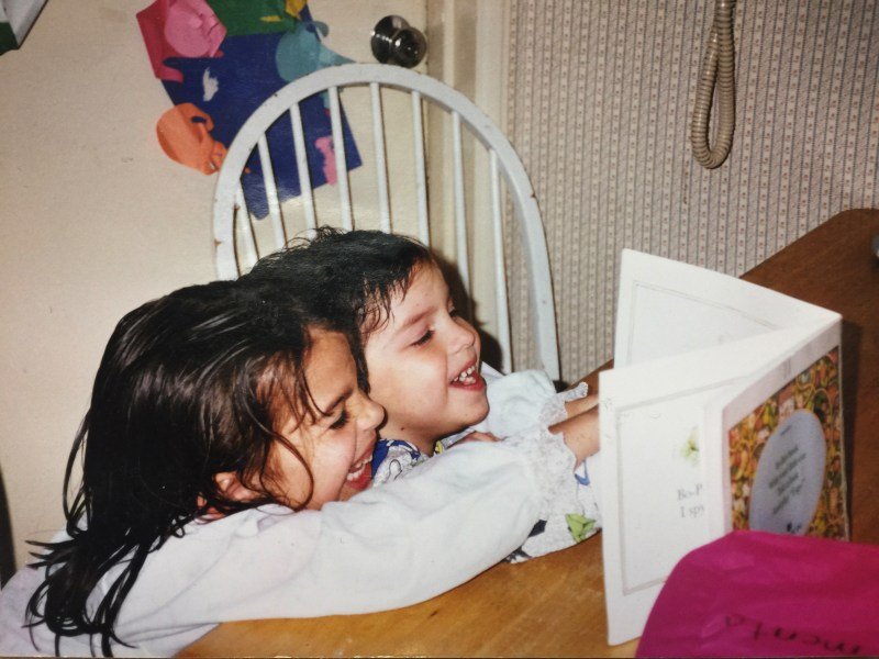 Me reading a book to my brother when I was seven-years-old.