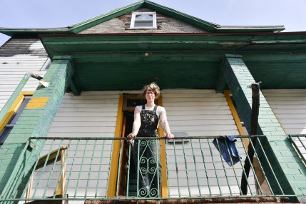 LaPonte, 26, stands on the porch of her home.
