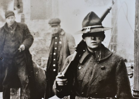 An Ohio National Guardsman watched by workers after the guard was called in when striking Youngstown Sheet and Tube workers burned East Youngstown down following a six hour riot.