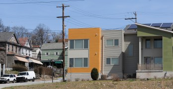 New energy efficient homes with solar panels have sprung up near some of the older homes in the town.