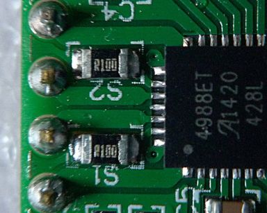 "An inexpensive ""Made in China"" Pololu-style A4988 stepper driver board using 0.1 Ohm current sense resistors, detail."