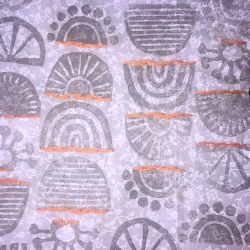 Example of embroidery using orange embroidery floss and hand printed upcycled fabric from reprint and repurpose.