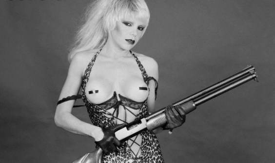 Singer Wendy O. Williams Barechested and Holding a Shotgun