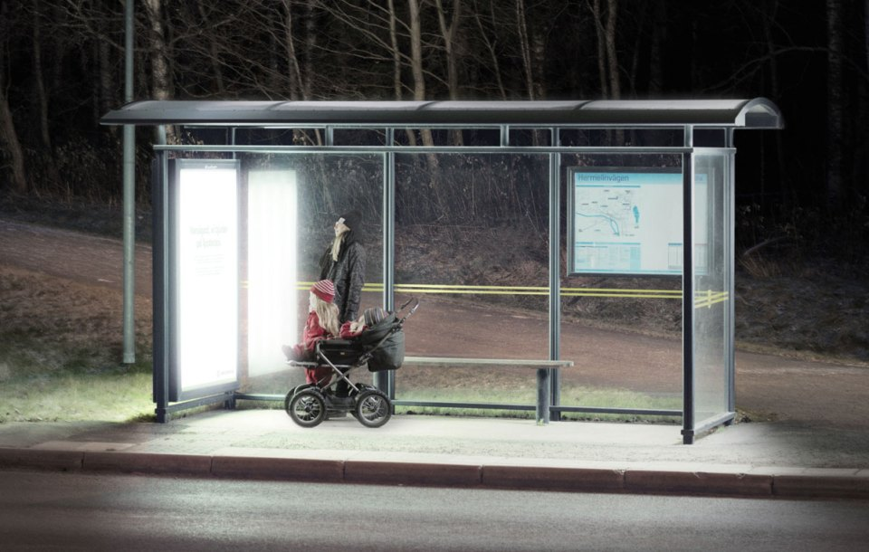"""Bus Stop in Umeå, Sweden, transformed into a """"light therapy"""" booth to boost public mental health during dark winter months."""