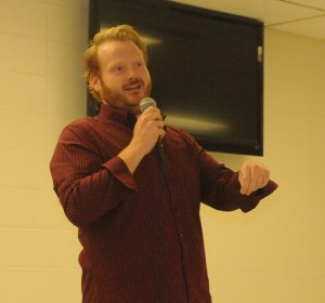 "R-T Photos/Diane Lowrey It was a full house in the Trenton High School Commons Saturday night as Trenton native Jeff Binney, at left, performed at a fundraiser for the Green Hills Animal Shelter. Binney, a 2001 graduate of Trenton High School, showed off his comedic talents during at 20-minute set featuring topics ranging from running an ultra-marathon to being born and raised on a pig farm. Thelma and Louise (aka Karen Rorebeck and Karen Glenn), pictured at right, along with THS student Cole Little served as the ""warm-up"" for Binney's performance. A chili supper and 50/50 raffle were also held, with the animal shelter raising around $2,000 for shelter operations."
