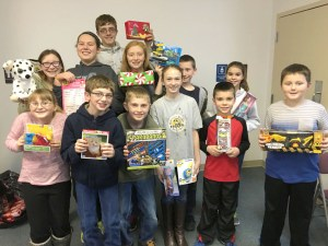 Members of the Helping Hands 4-H Club have collected toys to donate to local children for Christmas. Pictured are, from left, front row, Kinze Hanson, Levi Johnson, Seth Doolittle, Anna Hines, Mason Rongey, Josh Truitt; middle row, Tegan Kelsall, Latorrie Johnson, Elle Neal, Gaven Kelsall, Gracyn Rongey; back row, Wyatt Neal.