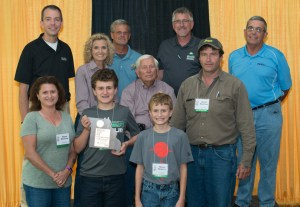 Photo Courtesy of Missouri State Fair The David Meservey family was honored as the Grundy County State Fair Farm Family during Missouri Farm Family Day on Aug. 15 at the state fair. The Meservey family was selected for the honor by the Grundy County Extension Council and the local Farm Bureau. They own a row crop cattle operation and are active in various county activities. Pictured are, from left, front row, Marcy Meservey, Warren Meservey, Mason Meservey, David Meservey; back row, Marshall Stewart, vice chancellor for extension and engagement with the University of Missouri Extension; Sherry Jones, state fair commissioner; Mark Wolf, state fair director; Lowell Mohler, state fair commissioner; Richard Fordyce, Missouri Director of Agriculture; and Blake Hurst, Missouri Farm Bureau President.