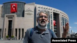 FILE - Erol Onderoglu, a journalist and Reporters Without Borders Turkey representative, talks outside a court in Istanbul, Turkey, July 16, 2020.