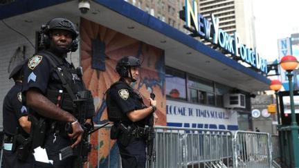 New York City police officers stand guard at Times Square on September 20, 2016 in New York City. (photo by AFP)