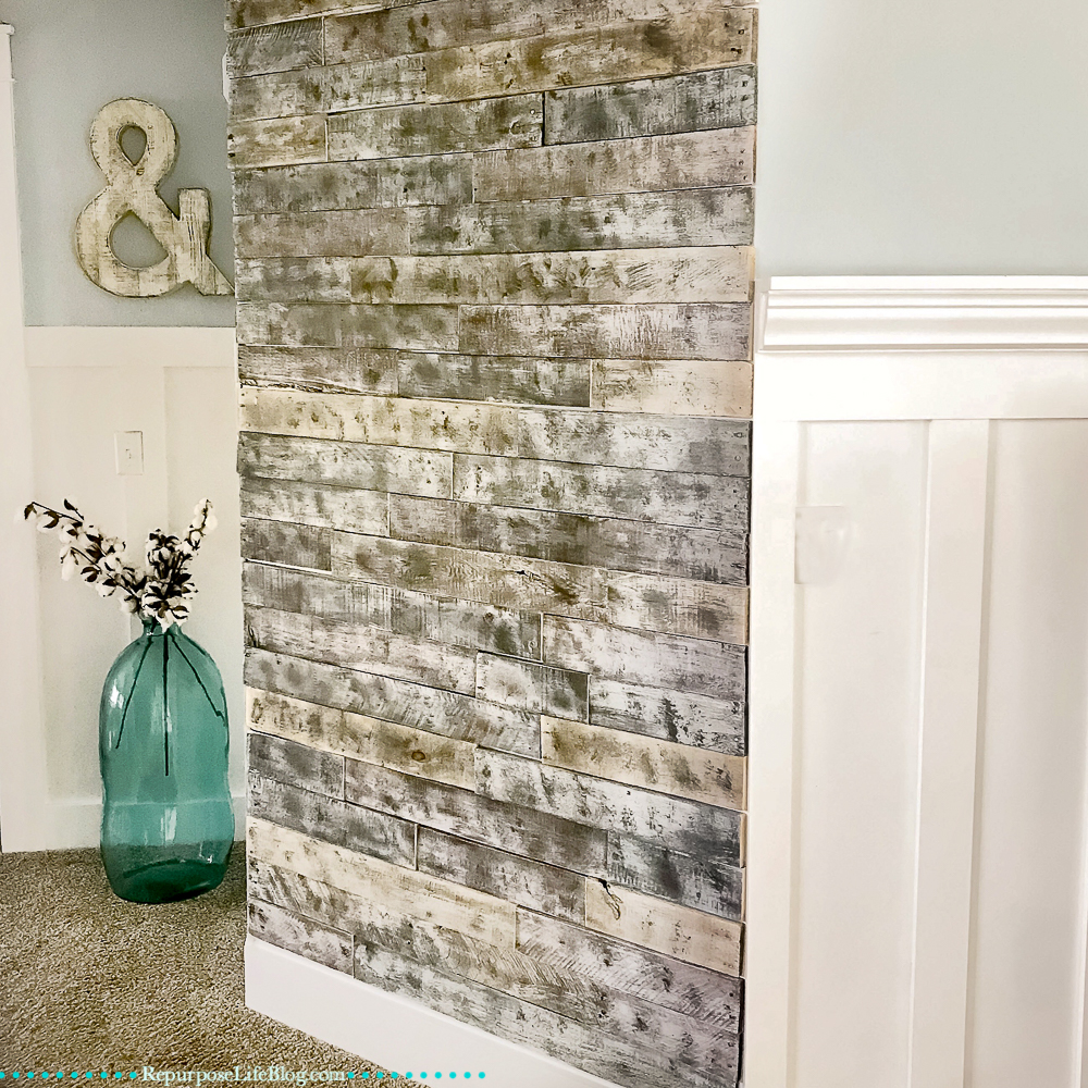 wall treatments and a large turquoise vase